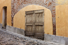 Old weathered doorway, Italy Stock Photography