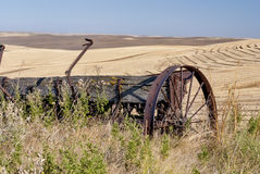 Free Old Weathered Farm Equipment In Wheatfields Royalty Free Stock Images - 26433909
