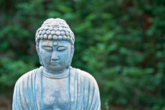 Old weathered garden buddha statue stock image