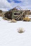 Old weathered Ghost Town buildings in the desert during winter with snow. Royalty Free Stock Photography