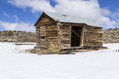 Old weathered Ghost Town buildings in the desert during winter with snow. Royalty Free Stock Images