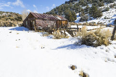 Old weathered Ghost Town buildings in the desert during winter with snow. Ione, Nevada Royalty Free Stock Photo