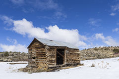 Old weathered Ghost Town buildings in the desert during winter with snow. Royalty Free Stock Image