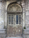 Old weathered gray wooden vintage door with decoration Royalty Free Stock Photo