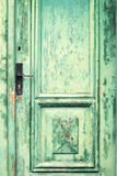 Old and weathered green door Stock Image