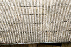 Old weathered grey roof texture. Made of an asbest Royalty Free Stock Photography