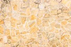 Vintage stone wall facade background texture. Old weathered grunge stone wall background texture, structure close up royalty free stock photo