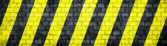 Old and weathered grungy brick wall with danger or attention black and yellow warning diagonal stripes texture background banner. Old and weathered grungy brick vector illustration