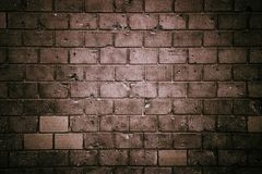 Dark tones brick wall: old and weathered grungy gray concrete block brick wall texture background. Old and weathered grungy gray concrete block brick wall stock photography