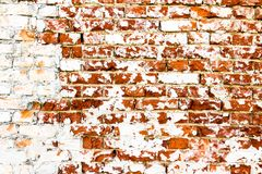 Brick wall: old and weathered grungy red brick wall partly painted with white peeling paint. Old and weathered grungy red brick wall partly painted with white royalty free stock photography