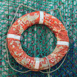 Old weathered lifebuoy on wooden wall Stock Photo