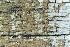 Old weathered mudbrick wall texture. Mud-brick construction is often adobe Stock Photo