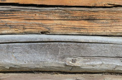 Old Weathered Natural Log Cabin Aged Wall Facade Fragment Texture. Rustic Log Wall Horizontal Grey Gray Background. Fragment Of Unpainted Brown Wooden Debarked royalty free stock photos