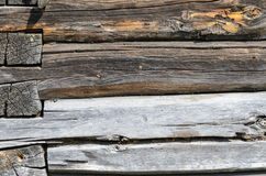 Old Weathered Natural Log Cabin Aged Wall Facade Fragment Texture. Rustic Log Wall Horizontal Grey Gray Background. Fragment Of Unpainted Brown Wooden Debarked royalty free stock image