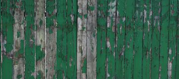 Old Weathered Natural Wooden Background Fragment Texture. Rustic Wooden Debarked Texture Green painting. Banner. Old Weathered Natural Wooden Background royalty free stock photography