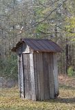 Old Weathered Outhouse with Rusting Tin Roof Royalty Free Stock Photography