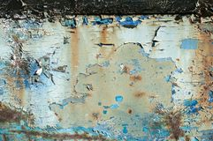Old weathered painted grunge metal sheet surface. With faded and cracked paint closeup as background stock photos