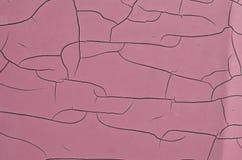 Purple faded peeling paint with random cracks pattern Royalty Free Stock Photography