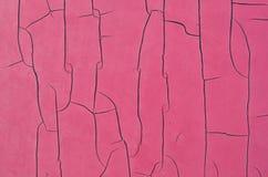 Weathered pink peeling paint on metallic surface Stock Image