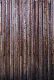 Old weathered planks outside facade. Wooden planks as an exterior wall finish are subject to the influences of the weather conditions royalty free stock images