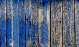 Old weathered planks painted in blue Stock Images