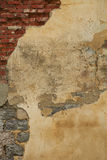 Old weathered plaster on the brick Wall Royalty Free Stock Photo