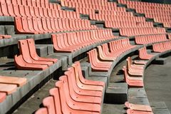 Old Weathered Plastic Seats in an old Stadium, using Shallow Dep Royalty Free Stock Images