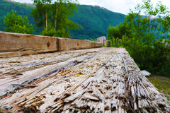 Old weathered railway sleeper in stack. An old wooden railway sleeper with splinters stock photos