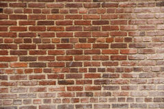 Old weathered red brick wall Royalty Free Stock Image