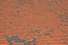 Old weathered red brown ceramic roof tiles Royalty Free Stock Photo