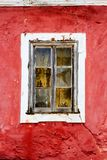 Old, weathered, red, mediterranean window. Old, weathered, red, mediterranean window in Portugal stock photo