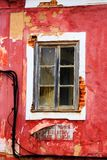 Old, weathered, red, mediterranean window. Old, weathered, red, mediterranean window in Portugal royalty free stock photography