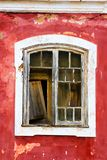 Old, weathered, red, mediterranean window. Old, weathered, red, mediterranean window in Portugal royalty free stock images