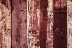 Old weathered red painted wooden fence texture stock images