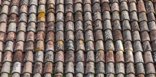 Old Weathered Red Tile Roof Closeup Photo. Background Stock Images