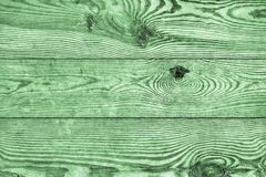 Old Weathered Rotten Knotted Stained Green And Varnished Pinewood Planks Cracked Flaky Grunge Texture Detail.  Stock Photography