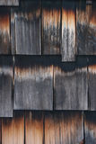 Old, weathered shake siding. Shake siding, possibly cedar, weathered on the side of an old house royalty free stock photography