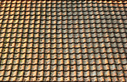 Old weathered shingle roof pattern background. Dirty and dingy s. Tained ceramic tiles texture Stock Images