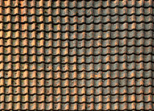 Old weathered shingle roof pattern background. Dirty and dingy stained ceramic tiles texture Royalty Free Stock Photography