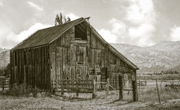 Old and weathered but still very servicable barn. Along County Road 1 in the Surprise Valley, California Stock Photos