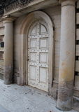 Old weathered stone building and arched door Stock Photo