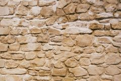 Old and Weathered Stone Wall. Background of Old and Weathered Stone Wall stock photo