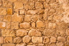 Old and weathered stone wall background, Royalty Free Stock Image