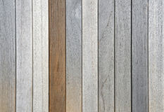 Old weathered teak planks and one oiled. Old dried weathered teak decking planks in row and one oiled Stock Photo