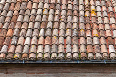 Old weathered tile roof background texture. Old weathered red tile roof background texture Stock Photo