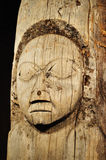 Old, Weathered Tlingit Totem Pole with Human Face Royalty Free Stock Photo
