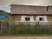 Old weathered traditional log cabin, Markakol, Kazakhstan. In summer Royalty Free Stock Image