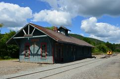 Old weathered train station in upstate New York on a beautiful summer day Stock Images