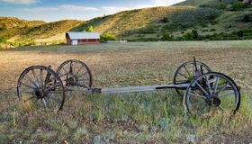 Old weathered wagon farm filed and barn Royalty Free Stock Images