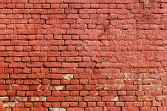Old weathered wall of red brick. Abstract background stock photo